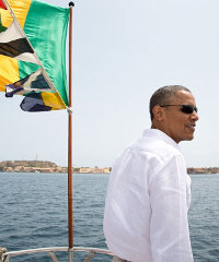 In this picture, taken yesterday, President Barack Obama stands on the bow of the ferry to Gorée Island, Senegal.